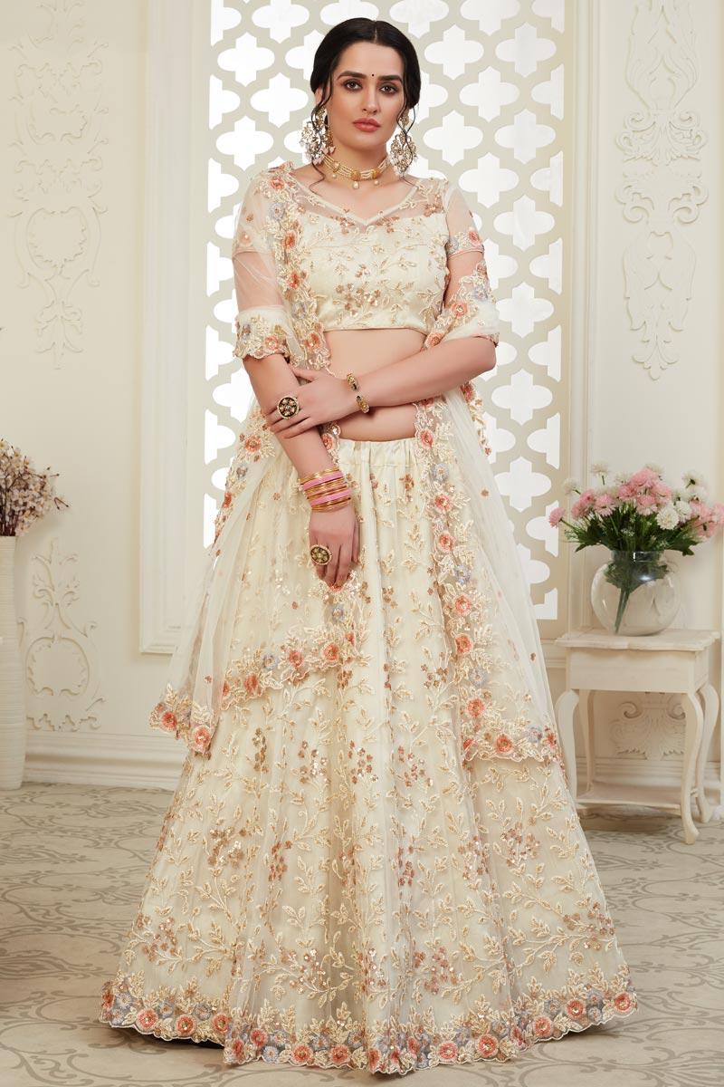 Net Fabric Sangeet Wear Cream Color Embroidery Work Lehenga