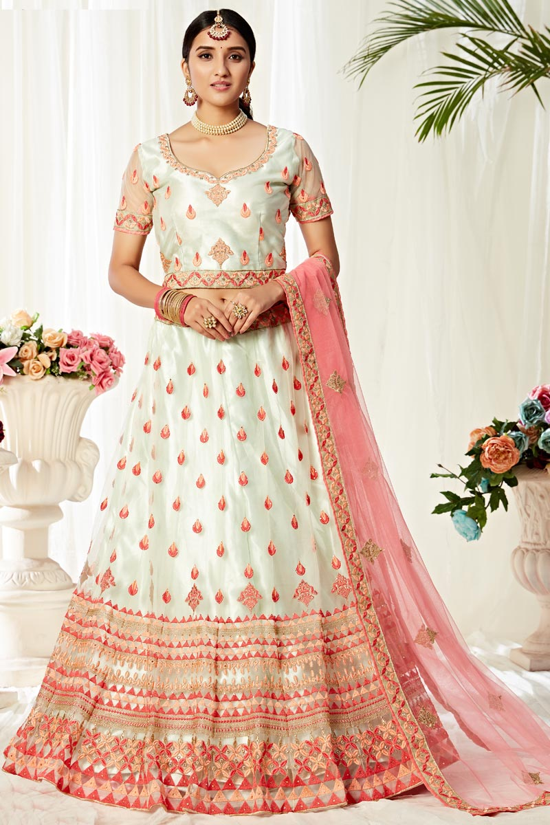 Sangeet Wear Net Fabric Thread Embroidered Off White Color Lehenga