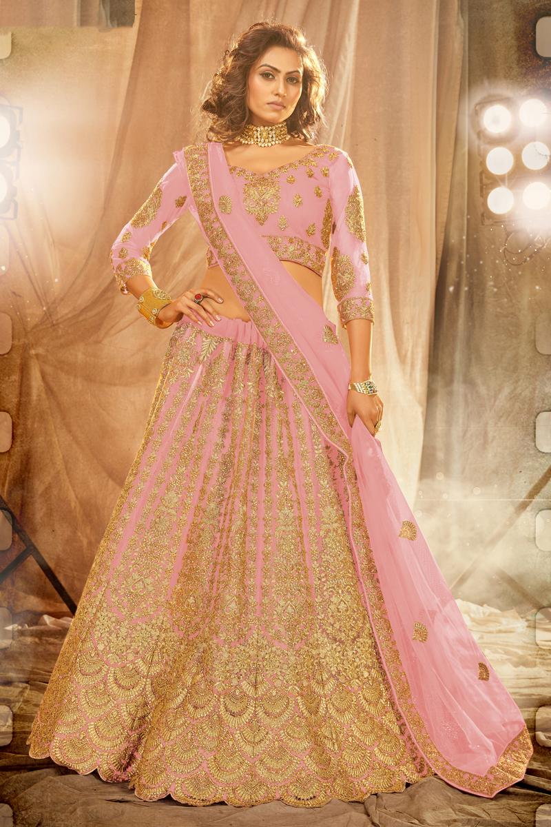 Wedding Wear Pink Embroidered Lehenga Choli In Net Fabric