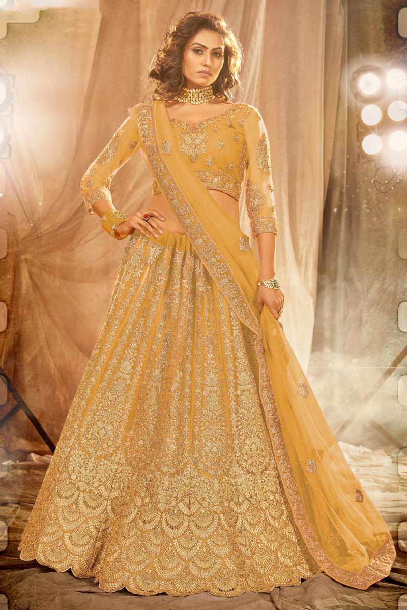 Wedding Wear Net Fabric Embroidered Lehenga Choli In Yellow Color