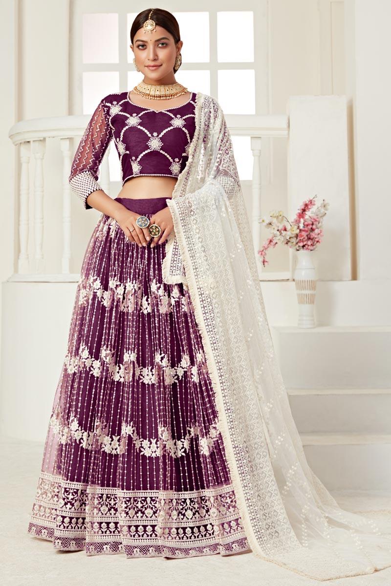 Sangeet Wear Purple Color Thread Embroiderd Lehenga Choli In Net Fabric
