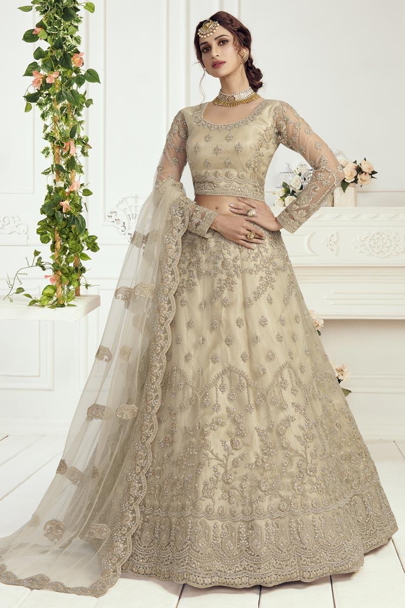 Trendy Cream Color Net Fabric Reception Wear Lehenga Choli