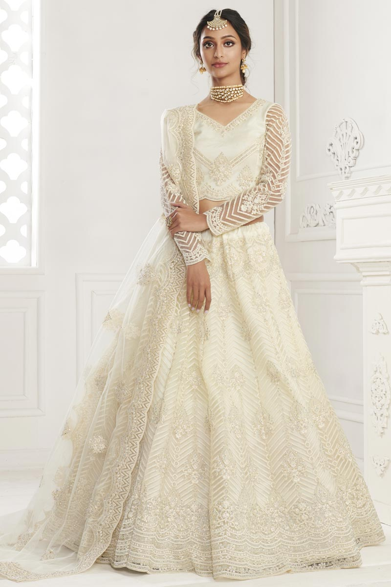 Net Fabric Fancy Wedding Wear Lehenga Choli In Beige Color