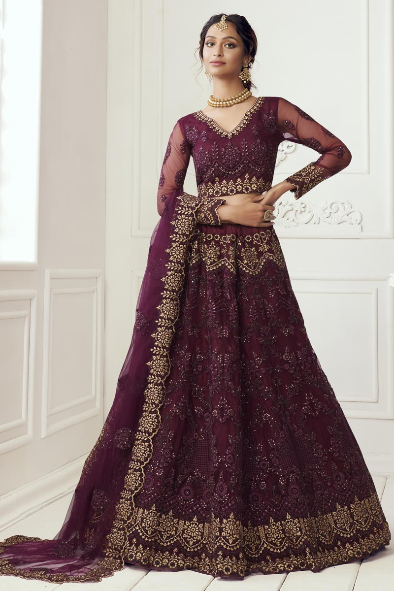 Trendy Sangeet Wear Lehenga Choli In Wine Color Net Fabric