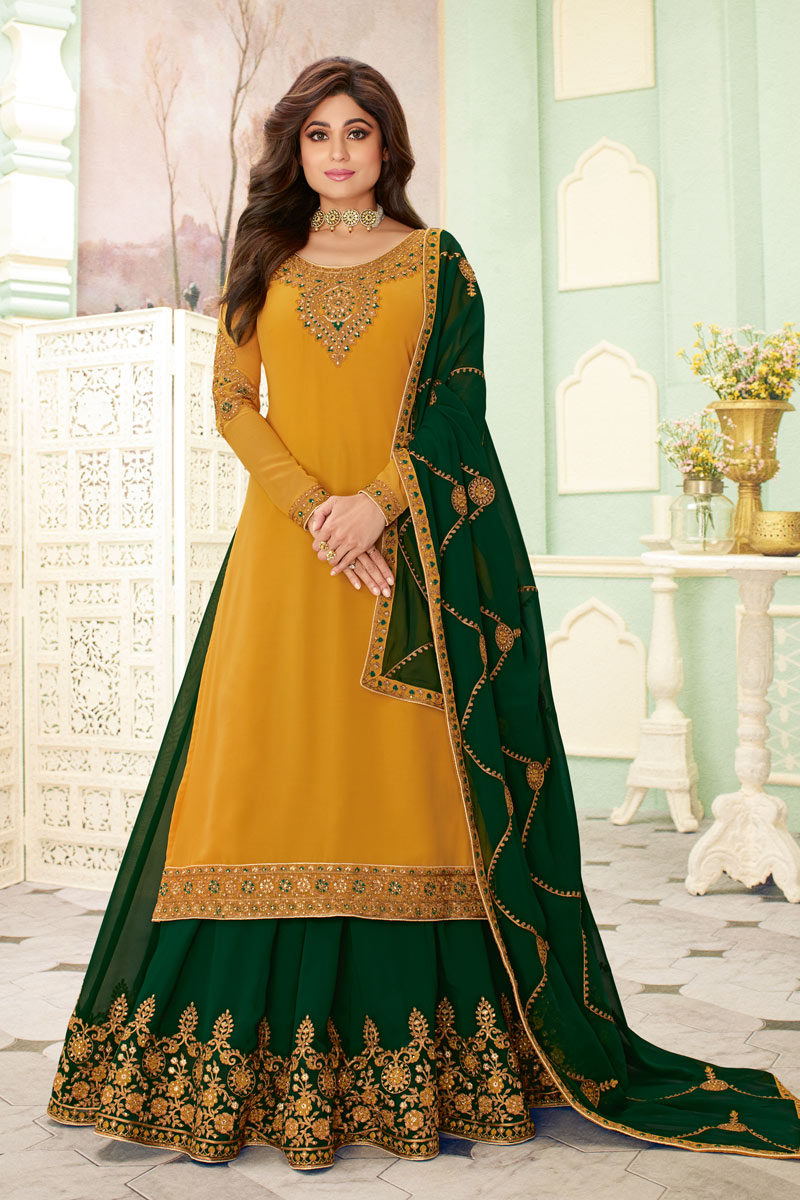 Eid Special Shamita Shetty Featuring Embroidery Work On Mustard Color Party Wear Georgette Fabric 3 Piece Sharara Top Lehenga