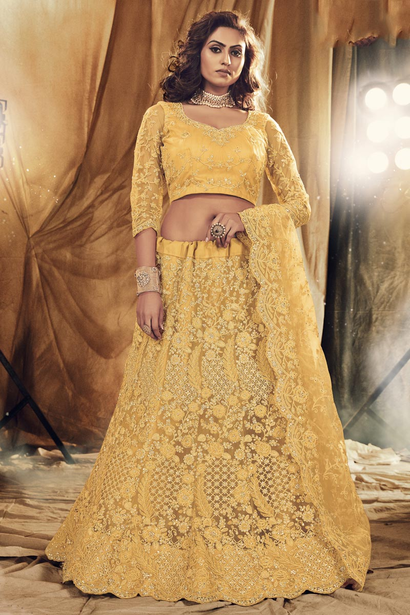Embroidered Stylish Lehenga Choli In Yellow Color Net Fabric
