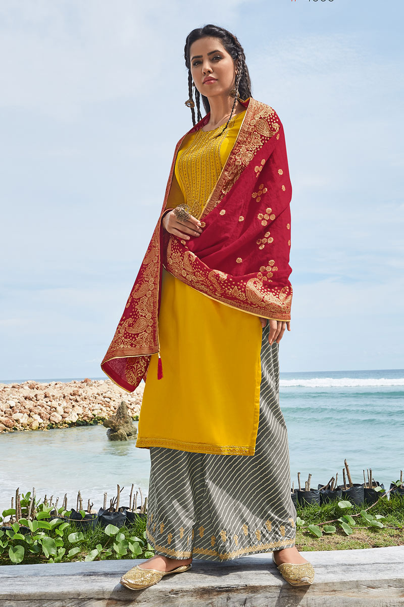 Eid Special Occasion Wear Mustard Color Palazzo Style Salwar Kameez In Fancy Fabric With Embroidery Work