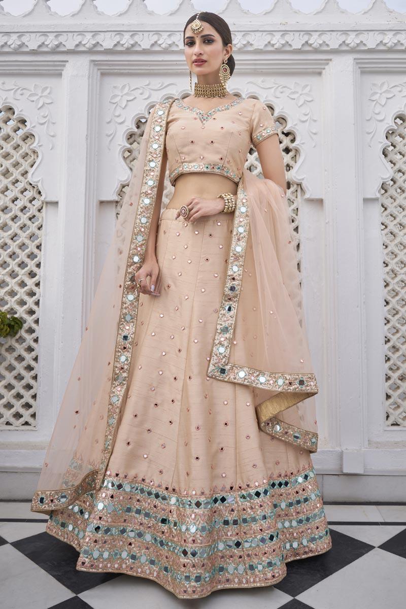 Sangeet Wear Silk Fabric Peach Color Mirror Work Lehenga Choli