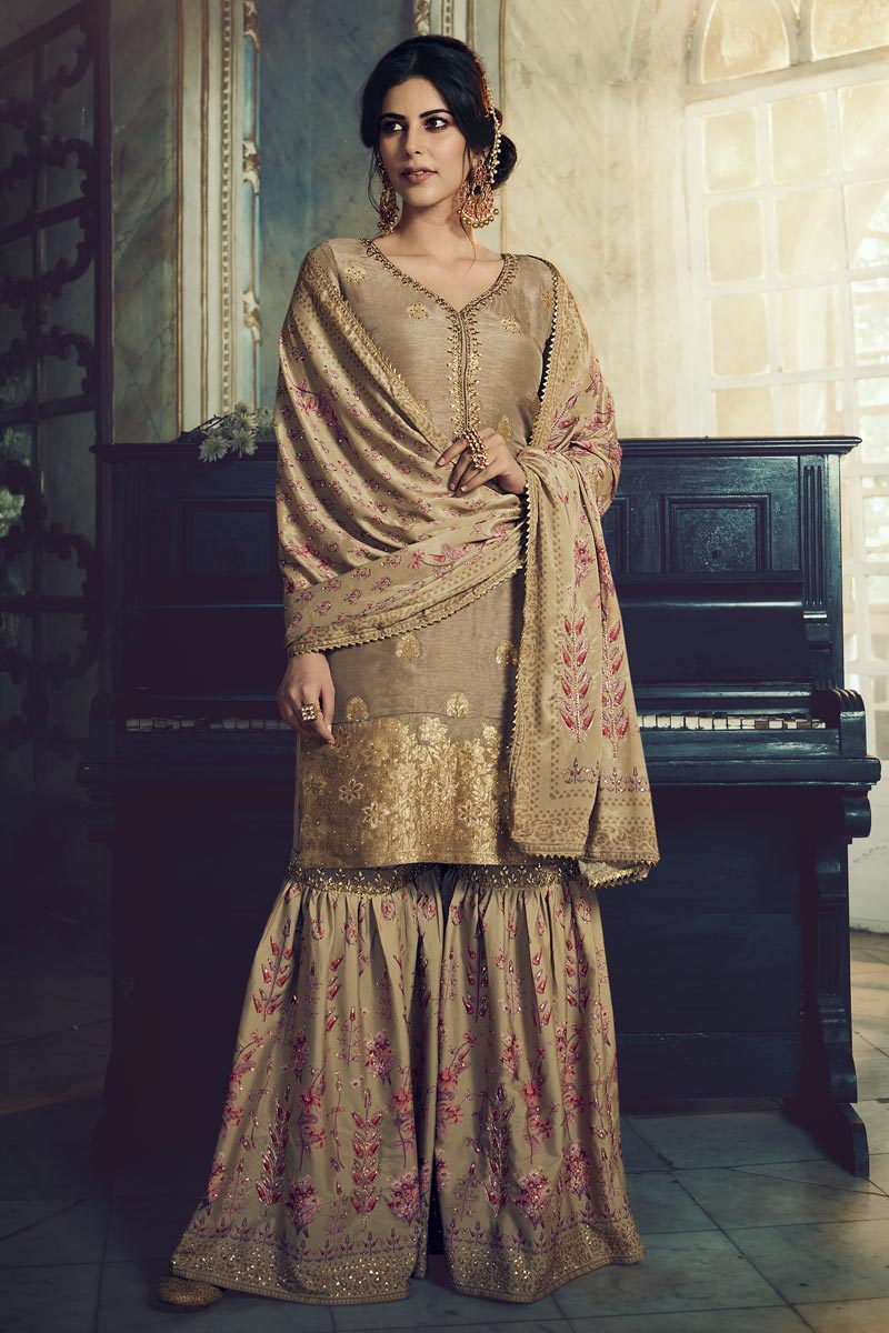 Function Wear Fancy Art Silk Fabric Embroidered Sharara Suit In Cream Color
