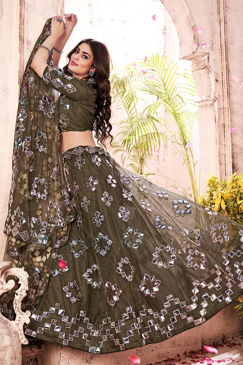 Wedding Wear Mehendi Green Color Fancy Work Lehenga Choli In Net Fabric