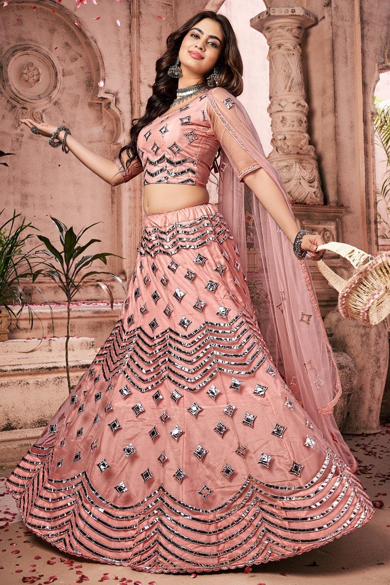 Net Fabric Wedding Wear Peach Color Fancy Work Lehenga Choli