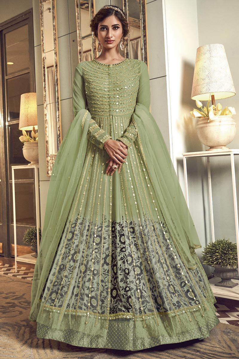Net Fabric Party Wear Anarkali Salwar Suit In Green Color With Embroidery Work
