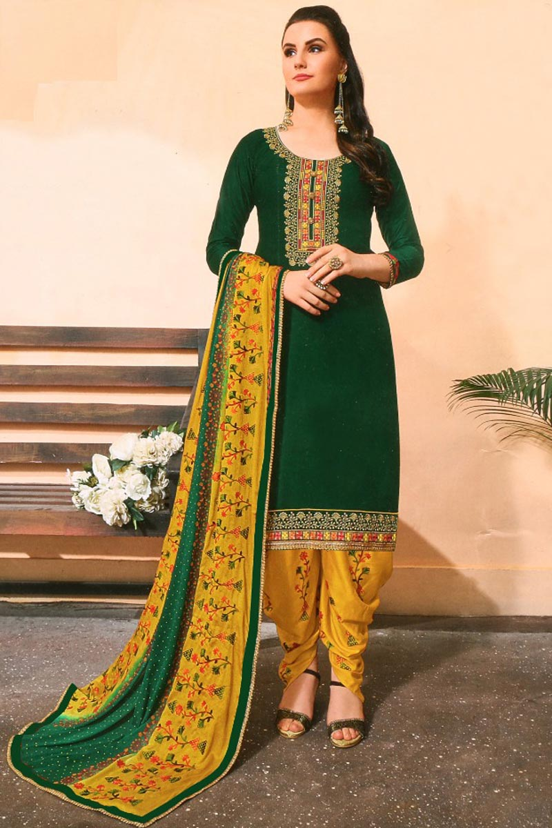 Trendy Festive Wear Cotton Fabric Embroidered Patiala Suit In Dark Green Color