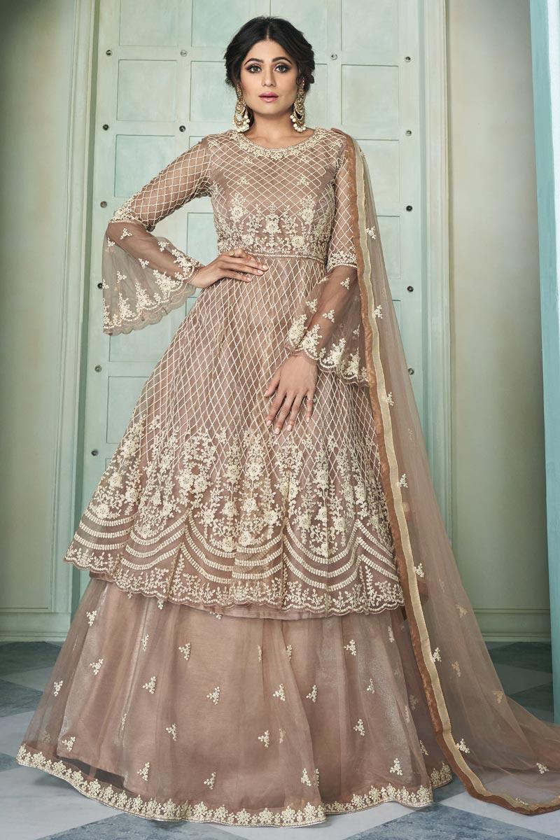 Shamita Shetty Chikoo Color Embroidered Function Wear Sharara Top Lehenga In Net Fabric
