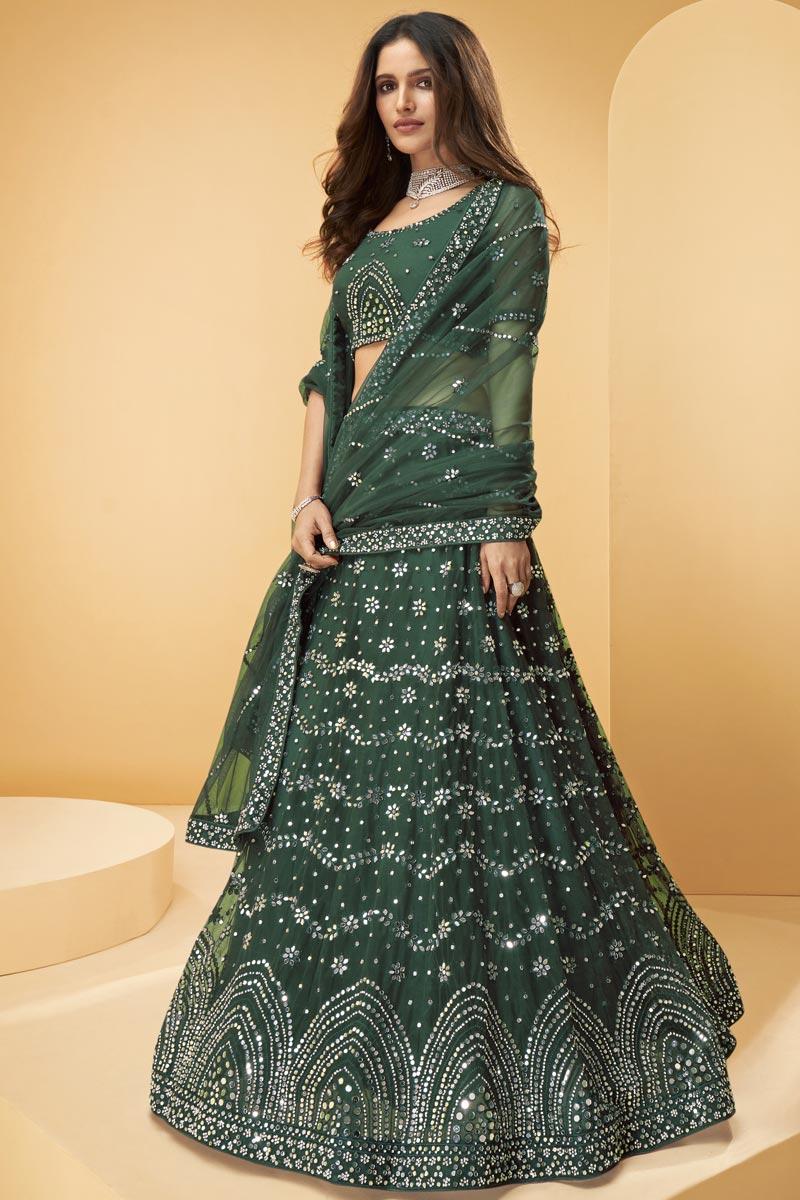 Wedding Wear Net Fabric Embroidered Lehenga Choli In Dark Green Color