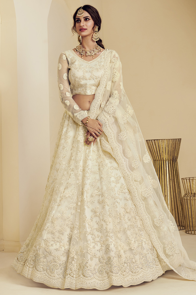 Fancy Net Fabric Sangeet Wear Off White Color Embroidered Lehenga Choli