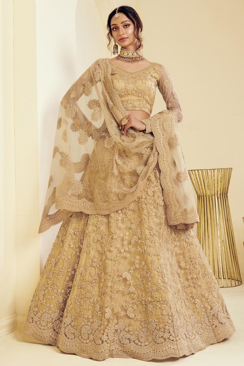 Net Fabric Sangeet Wear Fancy Golden Color Embroidered Lehenga