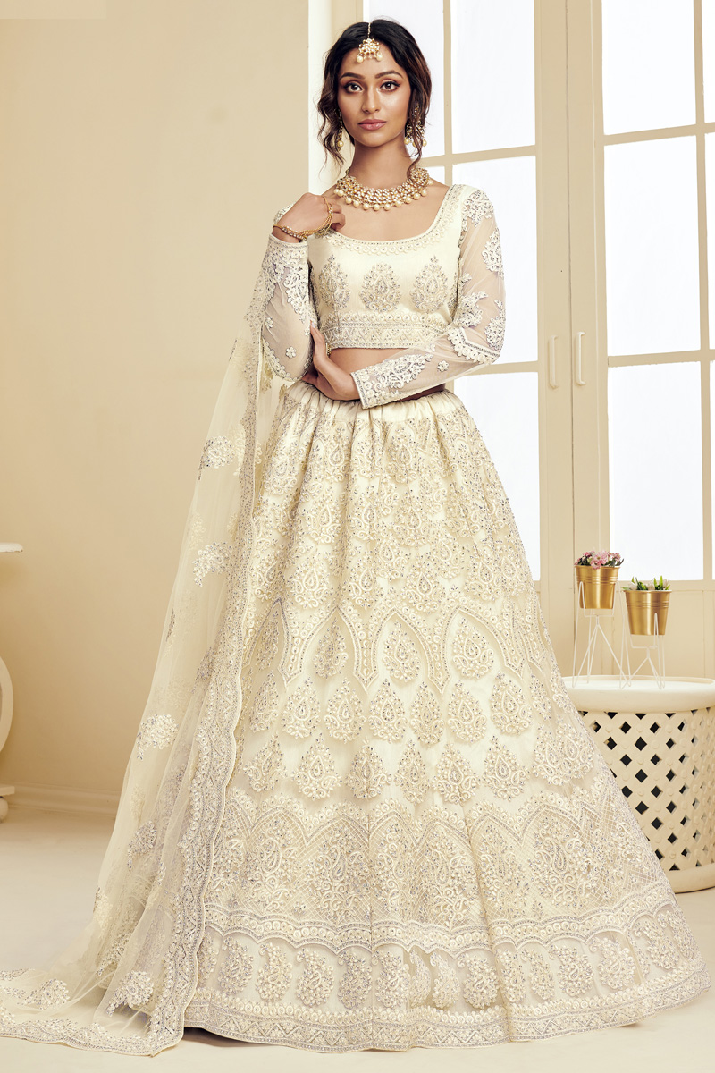 Sangeet Wear Fancy Off White Color Embroidered Net Fabric Lehenga Choli