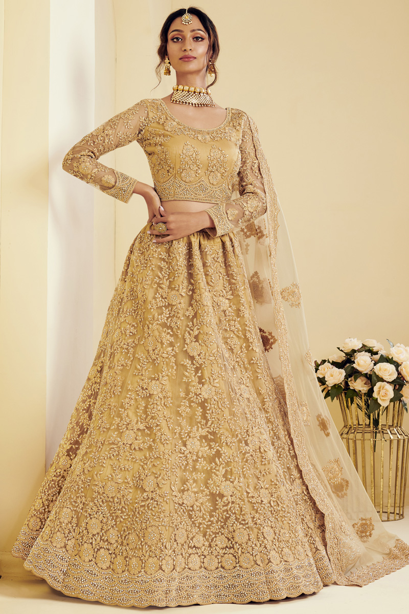 Fancy Golden Color Sangeet Wear Embroidered Lehenga In Net Fabric