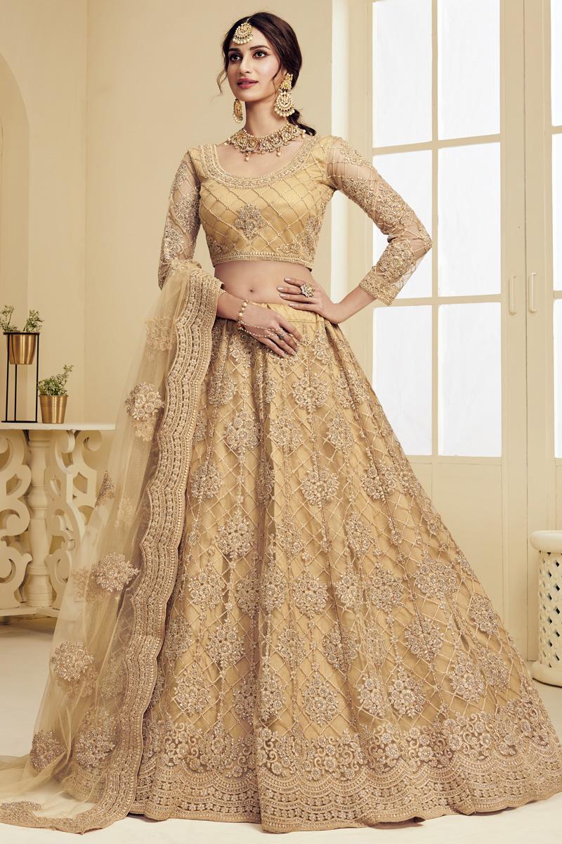 Golden Color Sangeet Wear Fancy Net Fabric Embroidered Lehenga