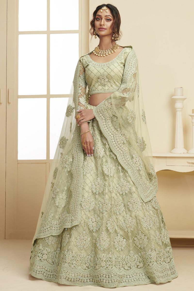 Fancy Net Fabric Sangeet Wear Embroidered Sea Green Color Lehenga
