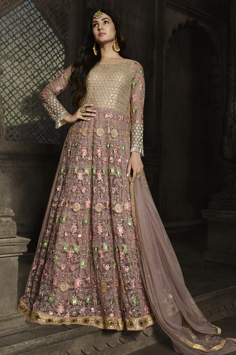 Sonal Chauhan Function Wear Embroidered Floor Length Pink Color Anarkali Dress In Net Fabric