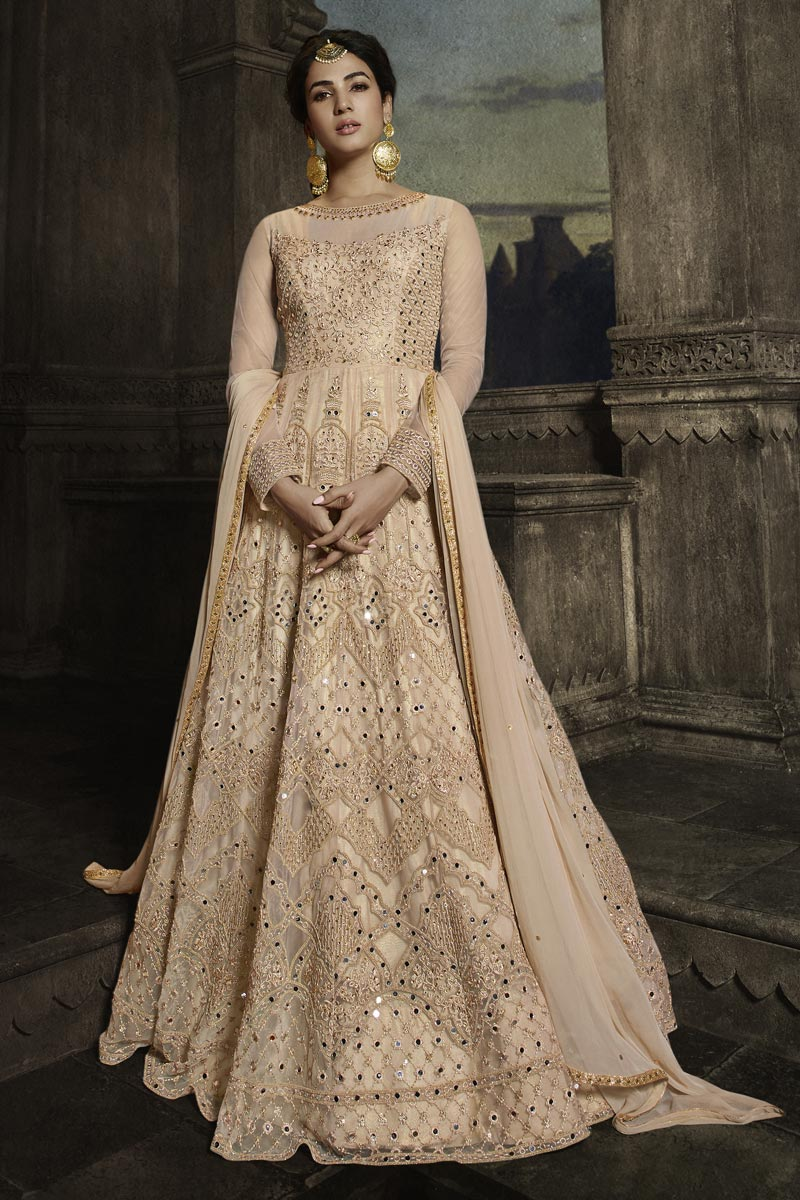 Sonal Chauhan Net Fabric Function Wear Embroidered Floor Length Anarkali Dress In Peach Color