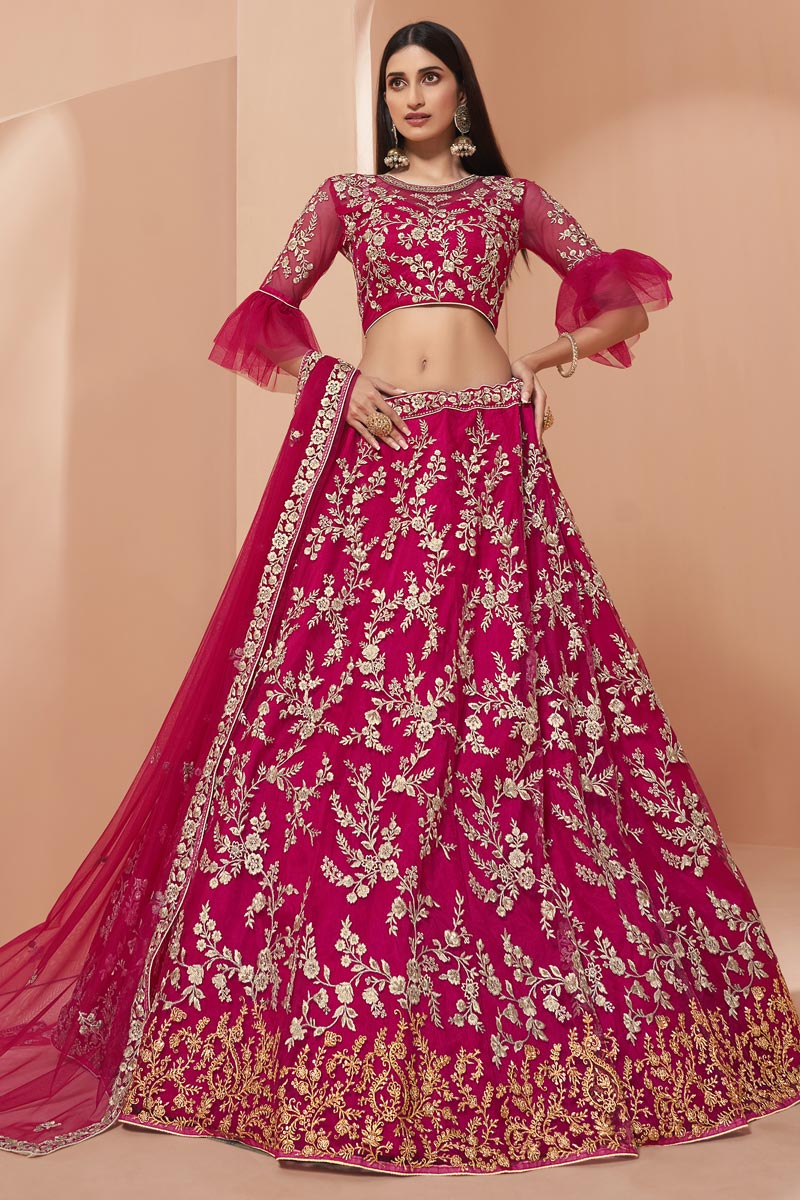 Wedding Function Wear Net Fabric Embroidered Lehenga In Rani Color