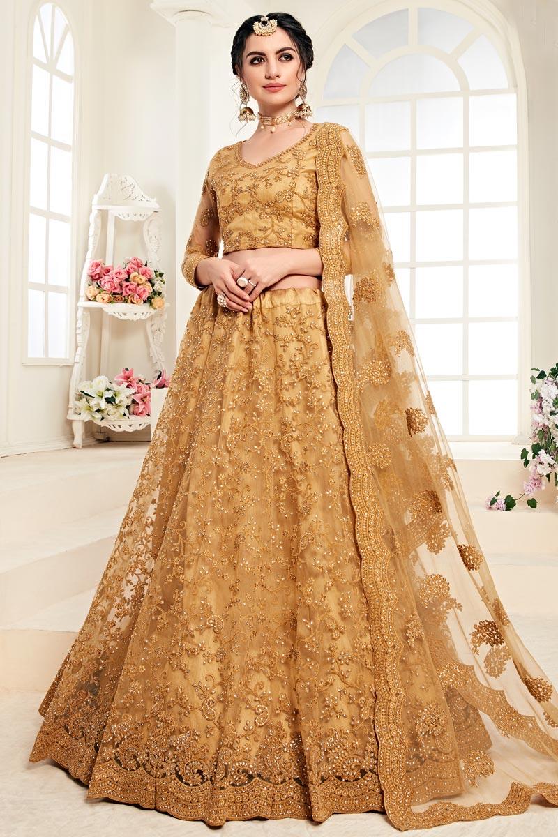 Mustard Function Wear Net Fabric Embroidered Designer Lehenga