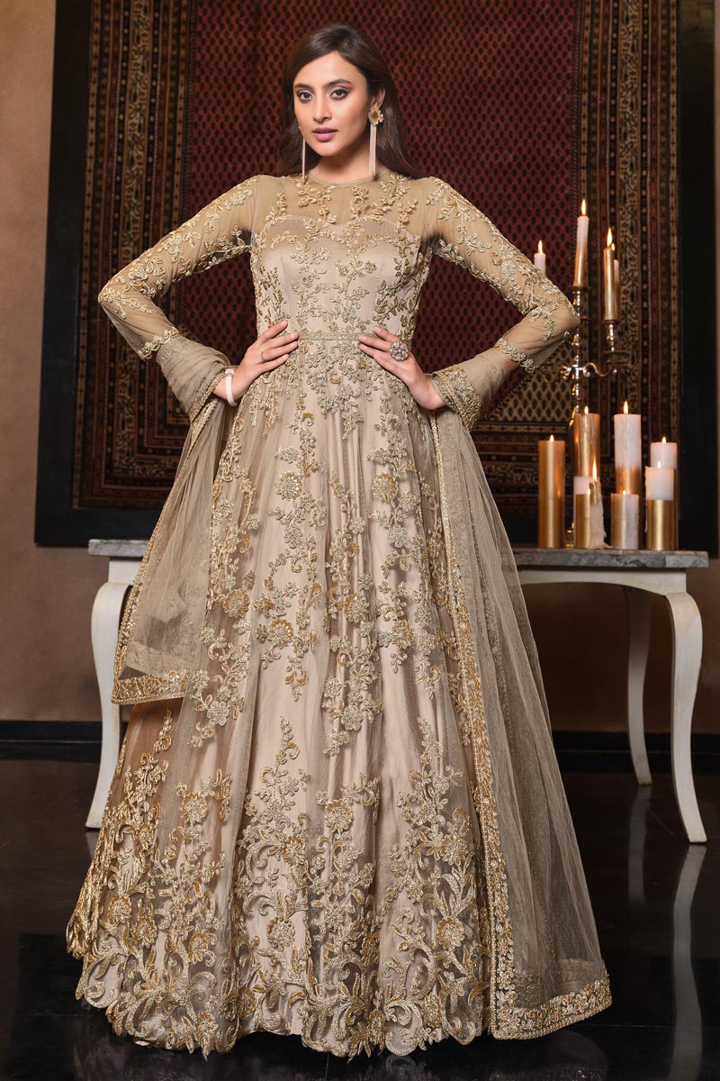 Sangeet Wear Cream Color Net Fabric Elegant Embroidered Gown Style Anarkali Suit
