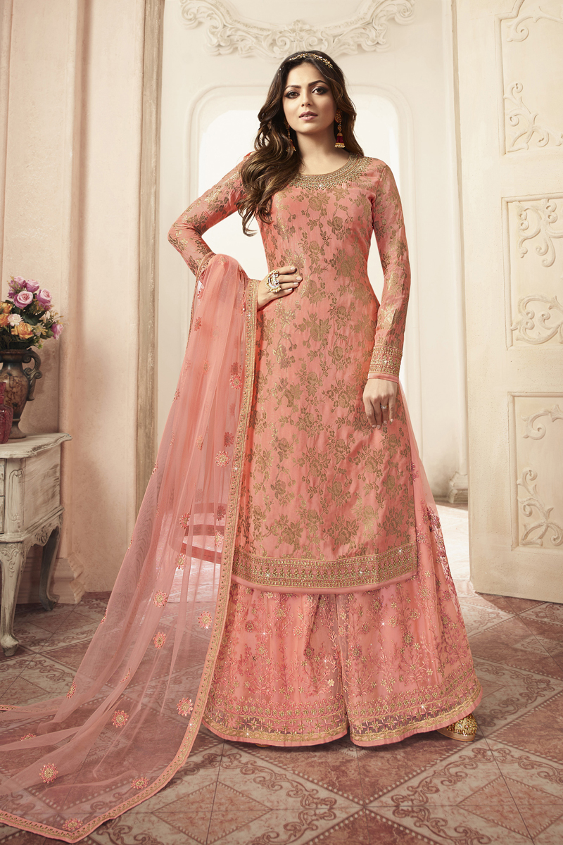 Festive Special Drashti Dhami Jacquard Fabric Party Wear Sharara Style Palazzo Salwar Suit In Salmon Color With Embroidery Work