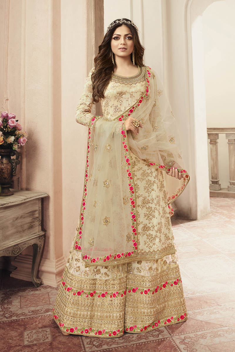Festive Special Drashti Dhami Occasion Wear Cream Color Embroidered Sharara Style Palazzo Salwar Kameez In Jacquard Fabric