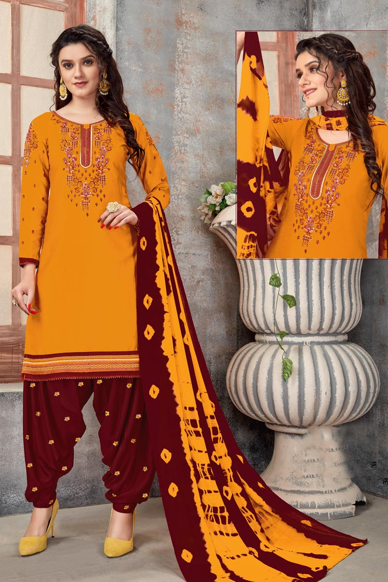 Regular Wear Cotton Fabric Mustard Color Embroidered Patiala Dress