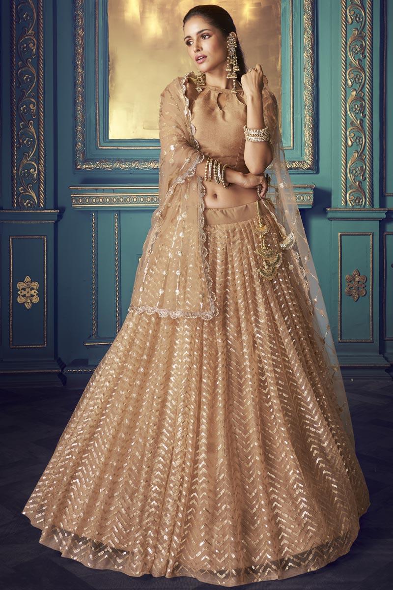Sangeet Function Wear Peach Color Lehenga Choli In Net Fabric