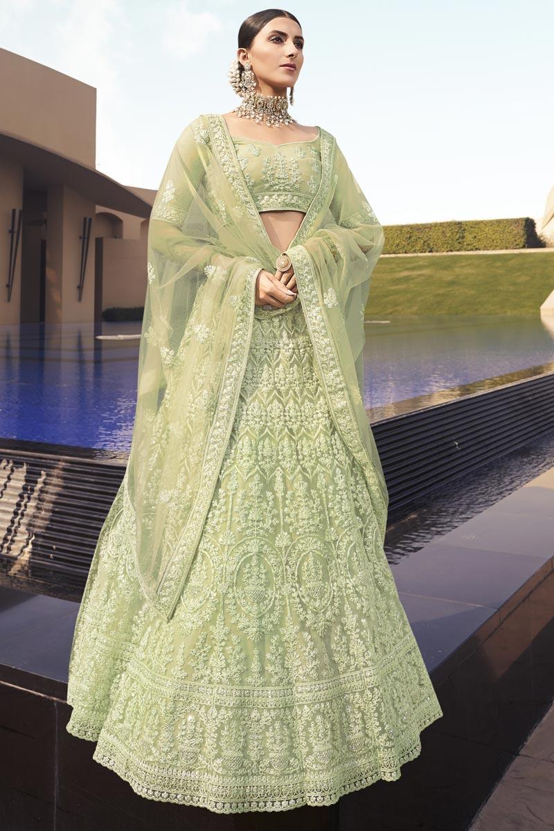 Sea Green Color Net Fabric Fancy Sangeet Wear Lehenga Choli