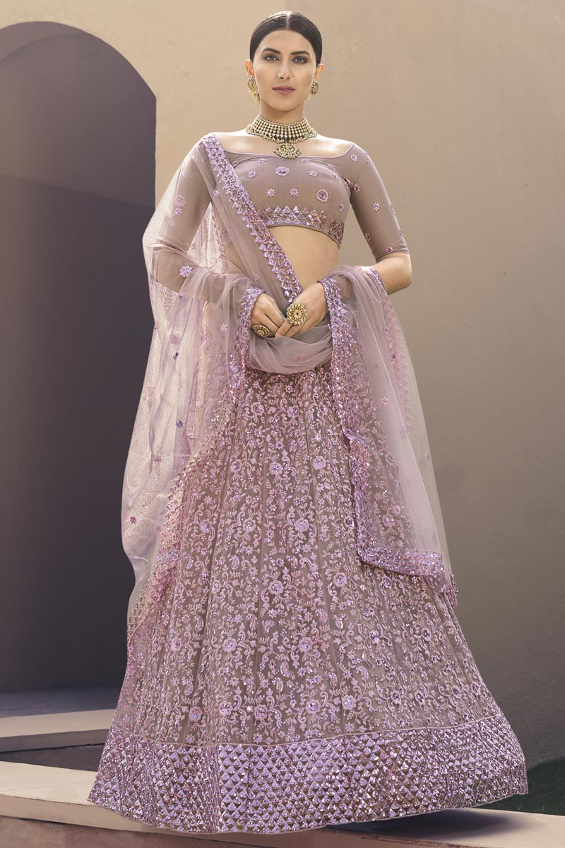 Lavender Color Reception Wear Lehenga Choli In Net Fabric