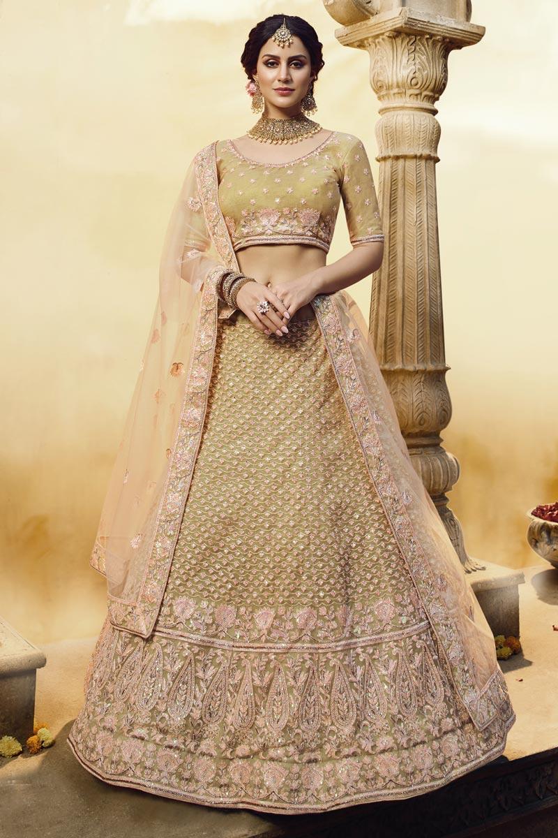 Embroidered Net Fabric Wedding Function Wear Yellow Color Lehenga Choli