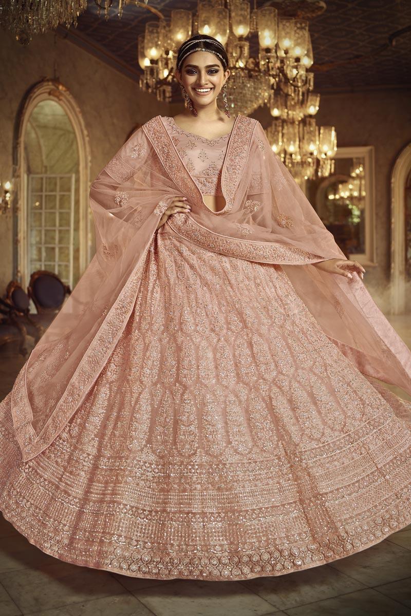 Fancy Embroidery Work Wedding Wear Lehenga Choli In Peach Color