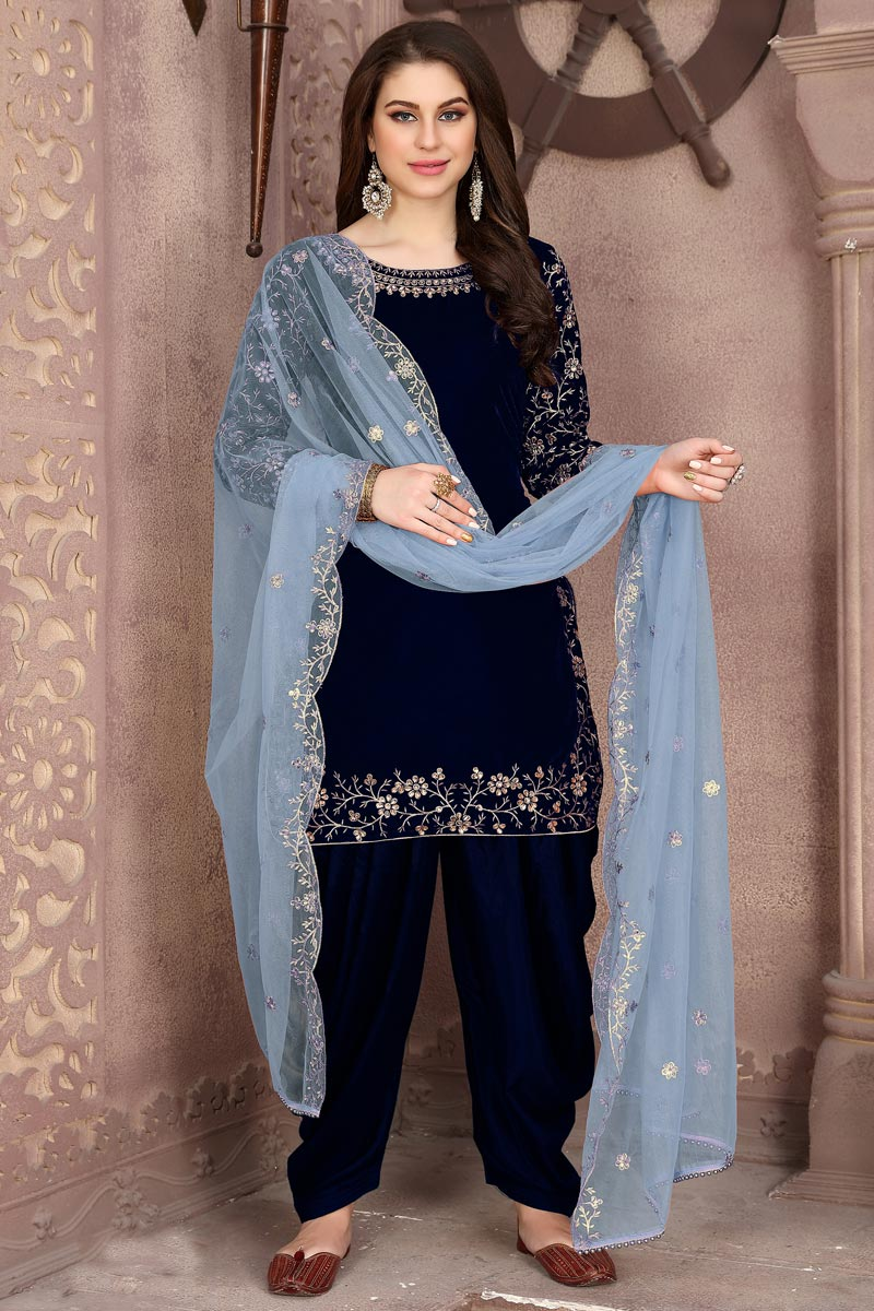 Velvet Fabric Embroidery Work Festive Wear Trendy Patiala Suit In Navy Blue Color