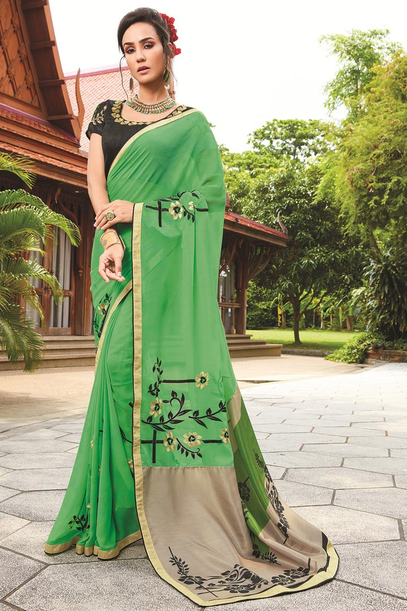 Hypnotic Georgette Party Wear Green Saree With Fancy Print
