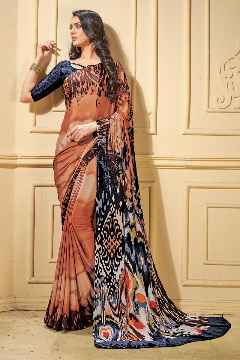 Stylish Abstract Printed Crepe Fabric Orange Casual Wear Saree