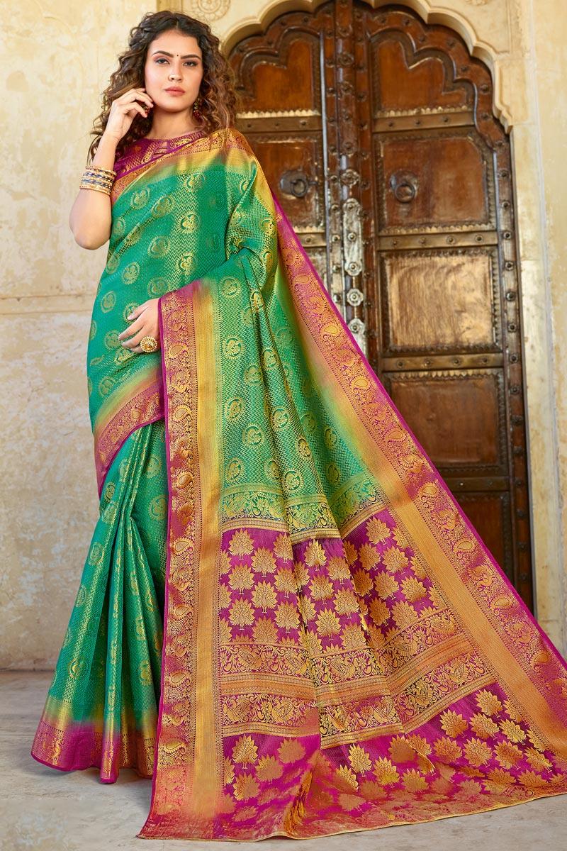 Green Color Festive Wear Fancy Weaving Work Saree In Art Silk Fabric