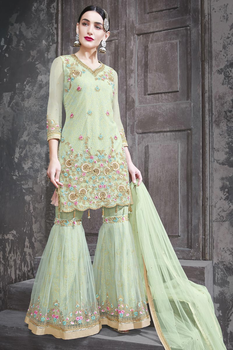 Function Wear Net Fabric Designer Embroidered Sharara Dress In Sea Green Color