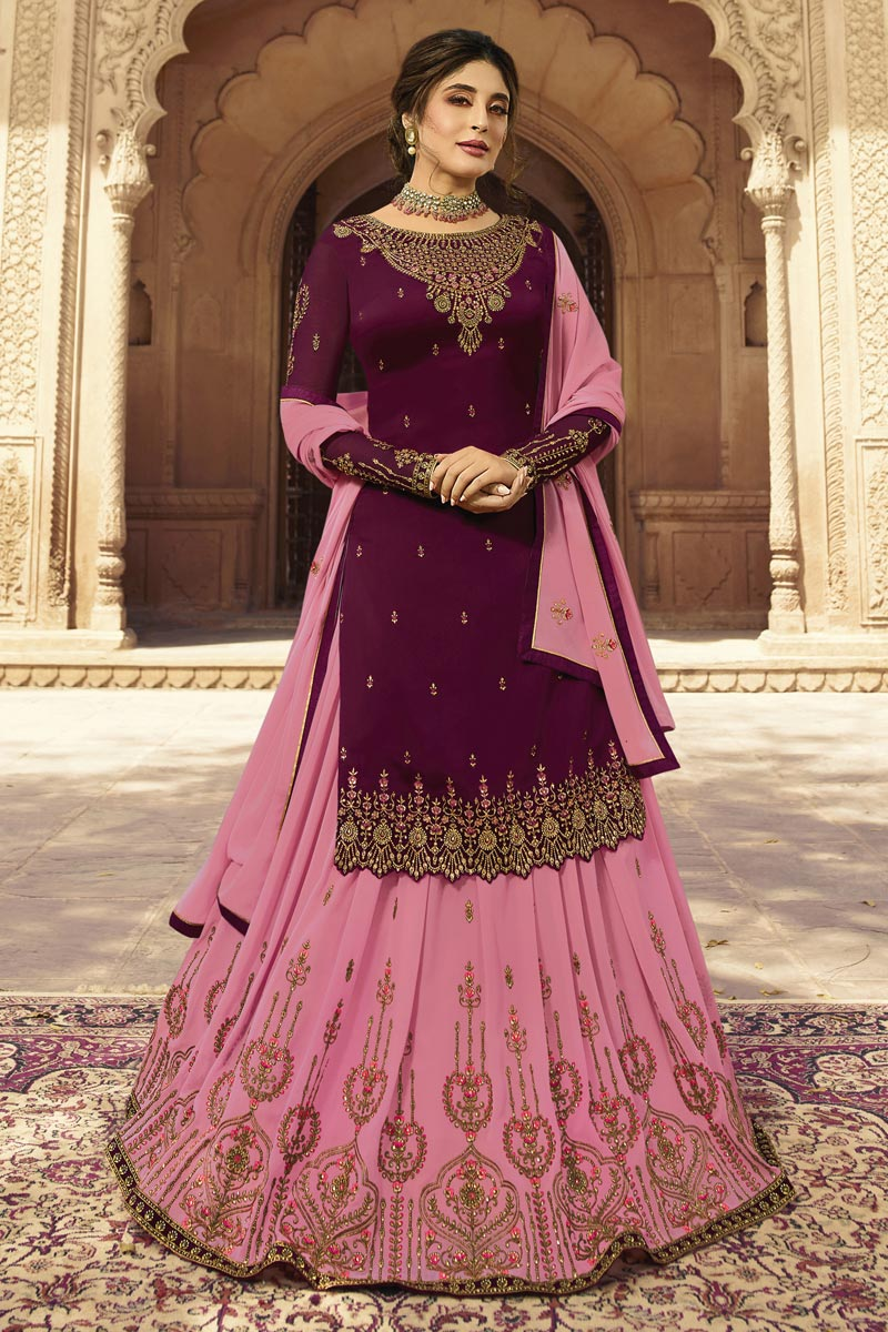 Kritika Kamra Wine Color Embroidered Function Wear Sharara Top Lehenga In Georgette Fabric