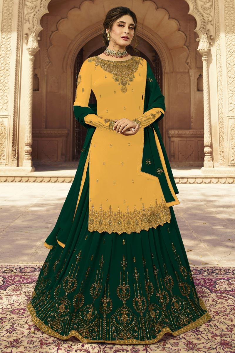Kritika Kamra Georgette Fabric Function Wear Embroidered Yellow Color Sharara Top Lehenga