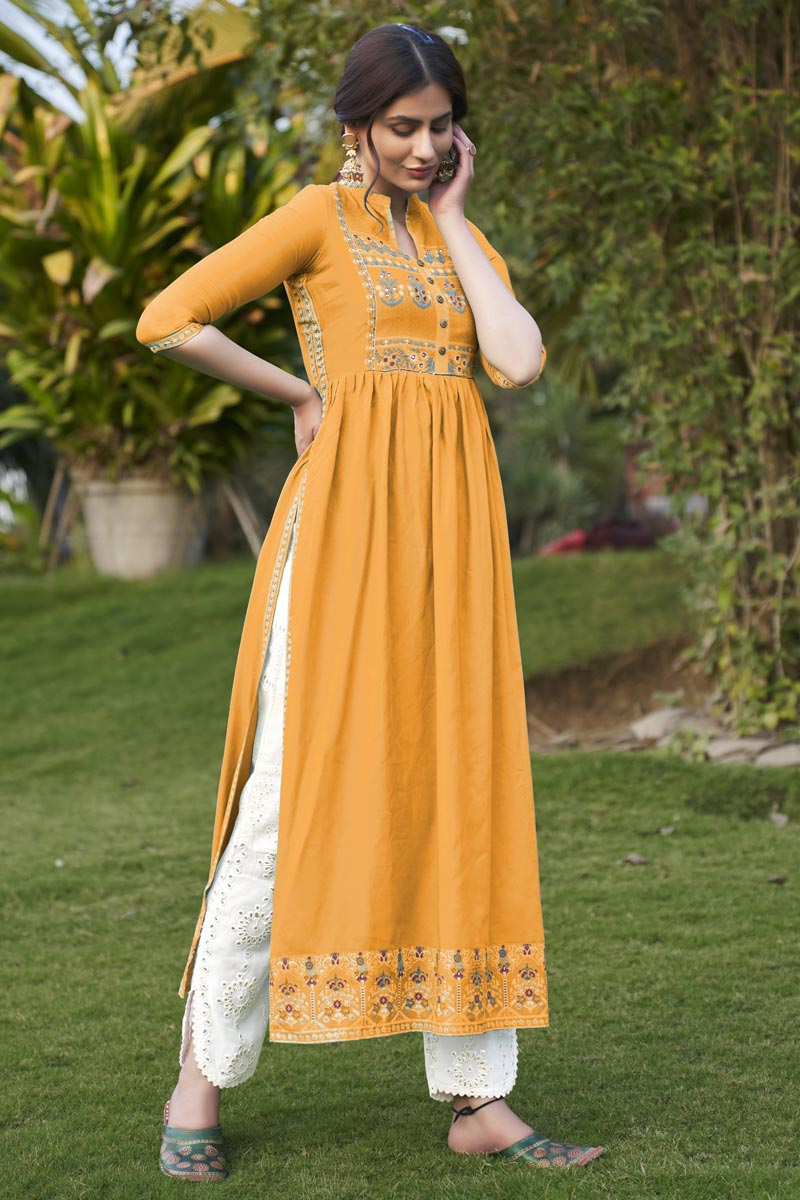 Mustard Color Party Wear Rayon Fabric Fancy Embroidered Kurti With Pant