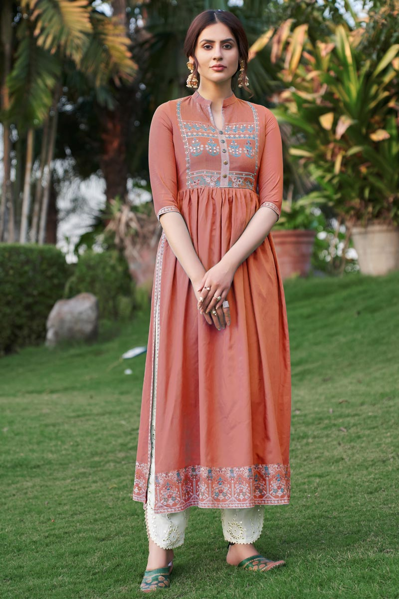 Party Wear Fancy Peach Color Embroidered Kurti With Pant In Rayon Fabric